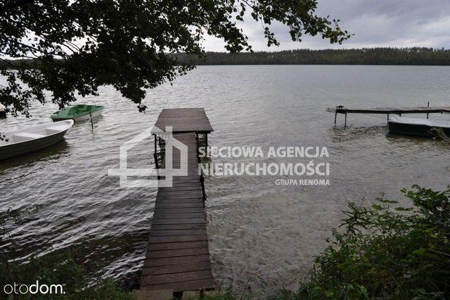 Duża działka nad jeziorem w Sulęczynie z lasem