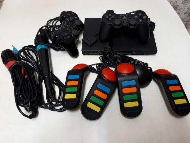 Playstation 2 slim + comandos + microfones