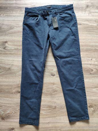 Męskie spodnie SLIM 34 Reserved NOWE