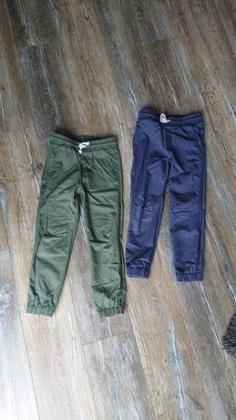 Joggersy H&M 122 dwie pary, zielone i niebieskie bawełniane joggery