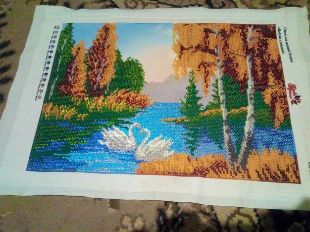 Пейзаж з лебедями