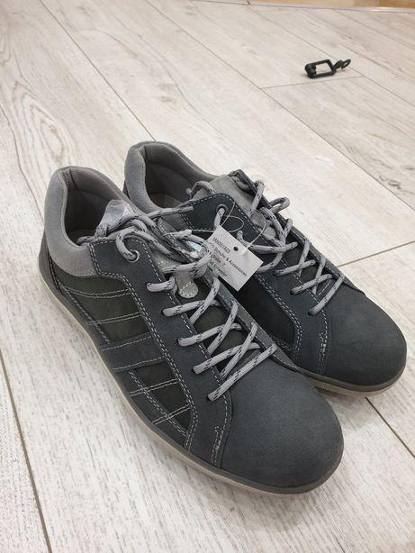 Продам новые мужские кожаные кроссовки