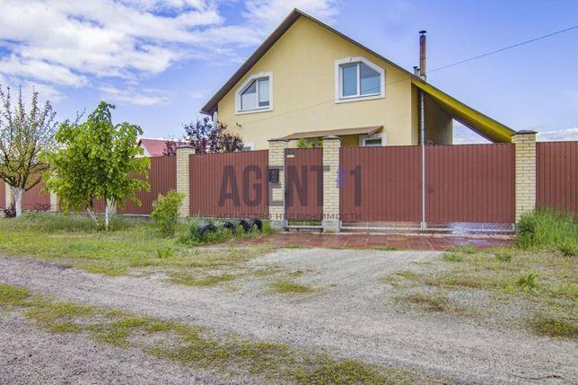 Продается дом 175 кв.м. и 15сот. по Житомирской трассе, с.Дмитровка.