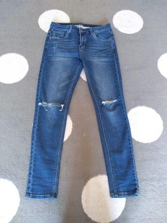 Dżinsy spodnie z dziurami 38