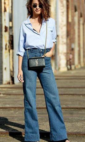 Модные новые джинсы клеш от бедра