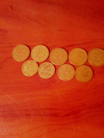 Монети 50 і 25 копійок