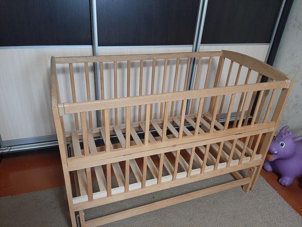 Кроватка дитяча маятник