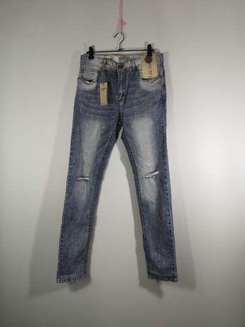 Spodnie z dziurami dżinsy Pull&bear