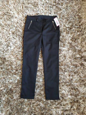Nowe spodnie ołówkowe rozmiar 40