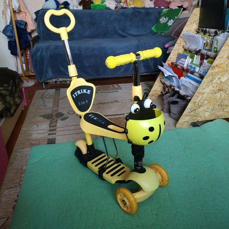 СамокатiTrike желтый в хорошем состоянии