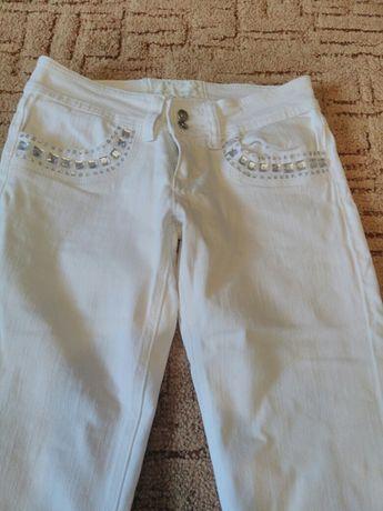 Biale dżinsy.polecam