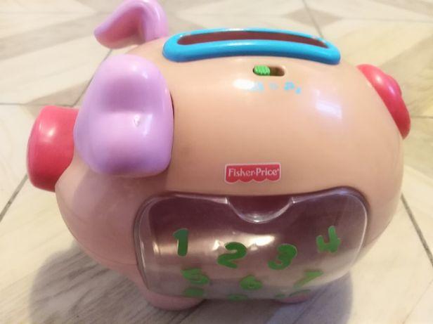 Fisher Price - świnka skarbonka