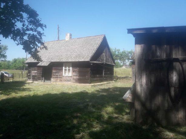 Drewniany dom z dużą działką nad rzeką Warta