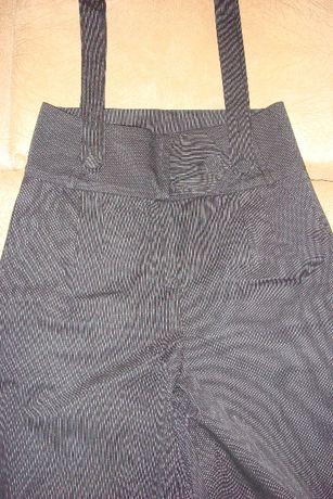 Стильные женские брюки клеш с подтяжками.