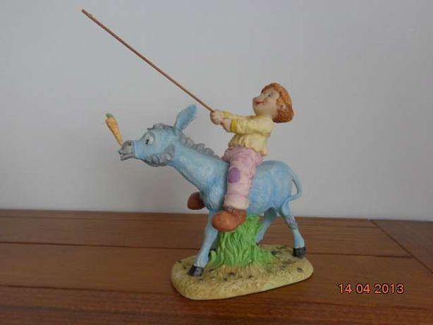 Estatueta menino a andar de burro