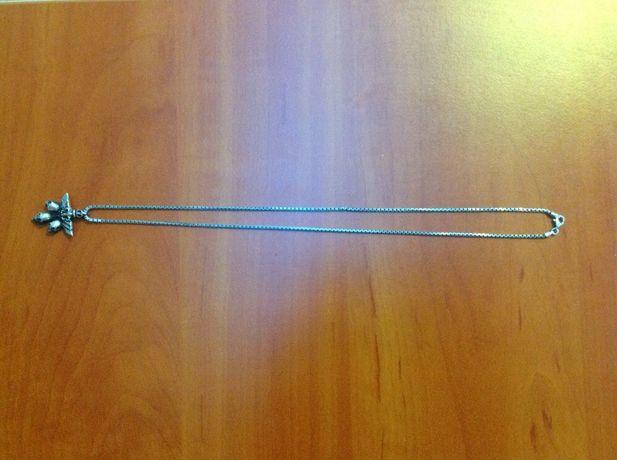 Подвеска мужская серебряная черепа с двумя цепочками.