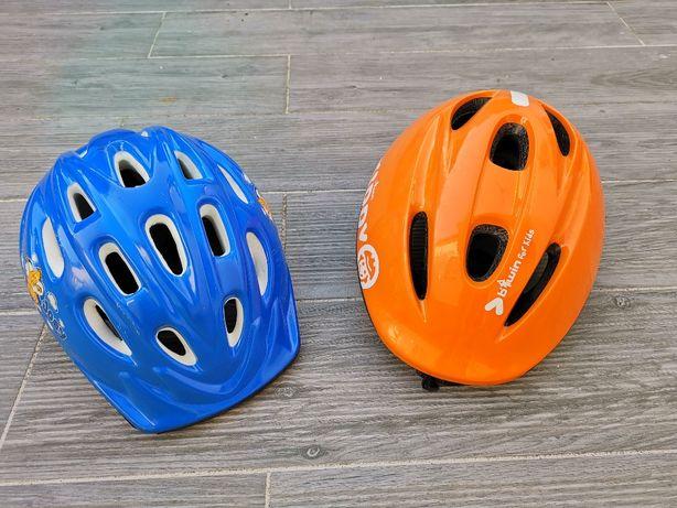 Dois capacetes de protecção para criança