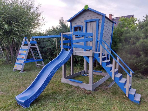 Plac zabaw domek huśtawka wieżyczka meble ogrodowe ślizgawka.