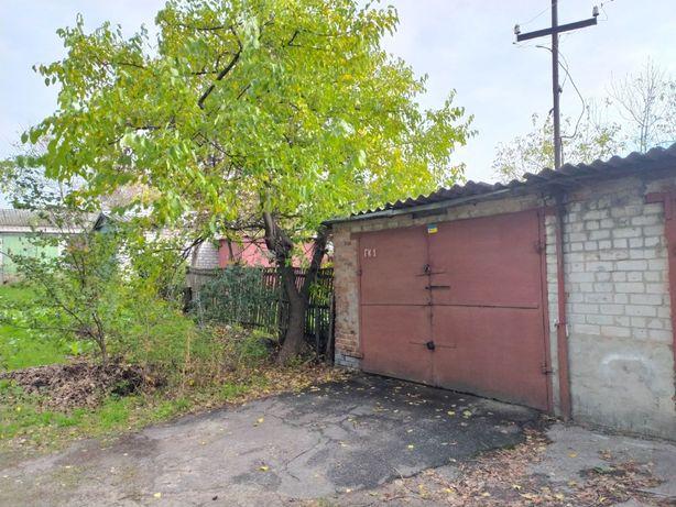 Кирпичный гараж с приватизированной землей