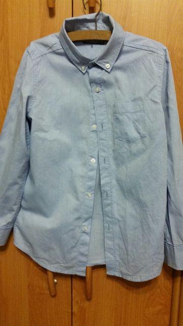 Koszula dla chlopca o wzroscie 134 cm