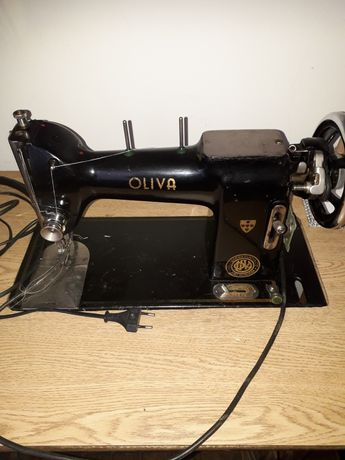Máquina de costura oliva
