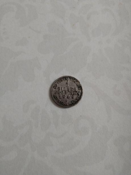 Srebrna moneta.