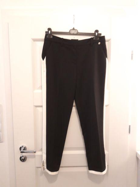 Spodnie Simple 38 czarne z białymi lampasami