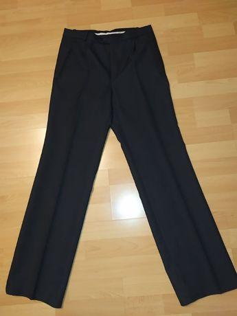 Spodnie garniturowe Nicol. Rozmiar 176/42.