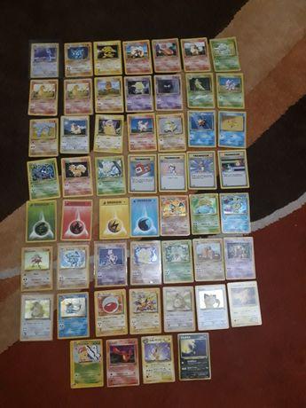 Cartas pokemon (charizard, venusaur) e várias 1a edição + 1 ano PSPlus