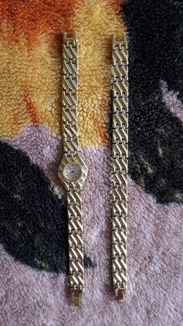 Женские наручные часы и браслет