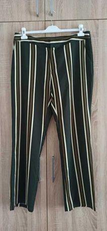 Materiałowe spodnie w paski