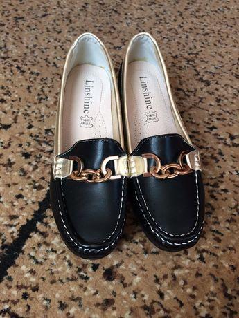 Нові жіночі туфлі