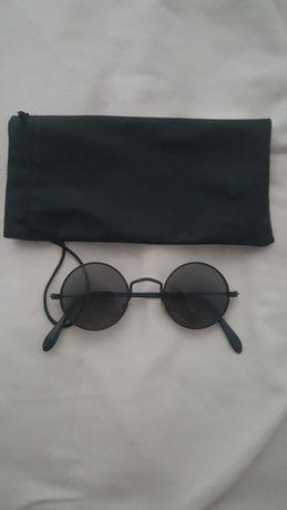 Óculos pretos redondos