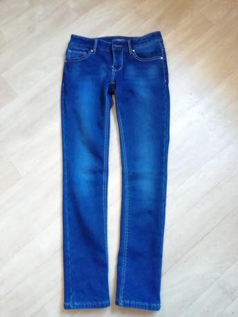 Женские джинсы на флисе р. 48