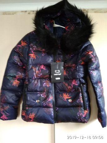 Продам зимнюю,демисезонную женскую куртку