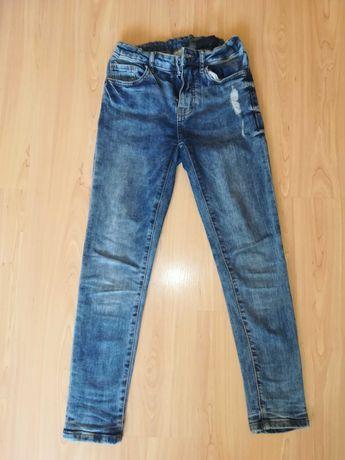 Spodnie wąskie jeansy z Zary