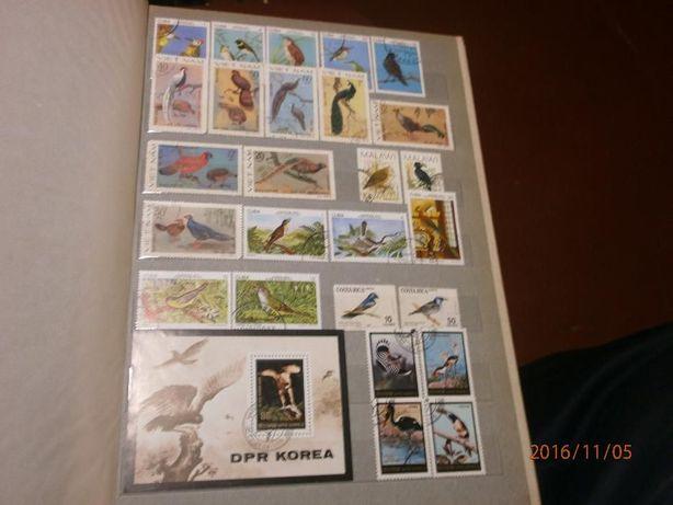 Продам большой альбом с марками: птицы 50% от стоимости