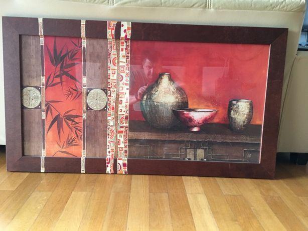 dekoracyjny obraz i afrykańskie figurki drewniane