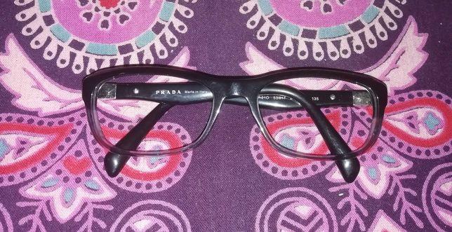 Armação de óculos preto e cinzento da marca Prada. Como nova.
