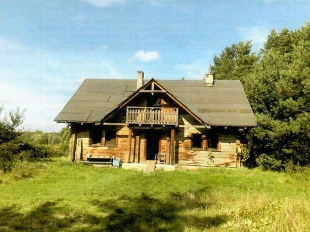 Syndyk sprzeda dom drewniany z działką 3.200 m kw. w Pieczyskach