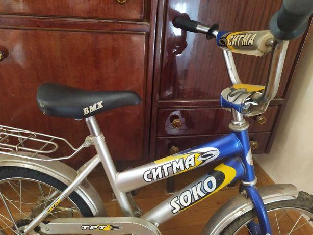 Четырехколёсный детский велосипед
