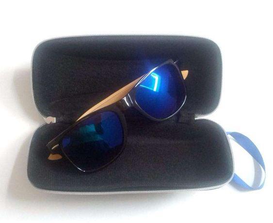 Elegantes óculos de sol, Unisexo, com caixa.