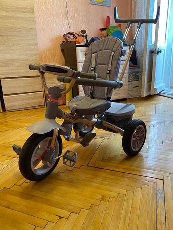 Продам детский трехколесный прогулочный велосипед с ручкой