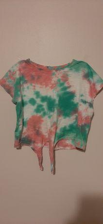 T-shirt (krótki) z wiązaniem na dole.