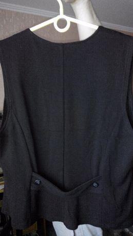 продам жилет женский цвет черный