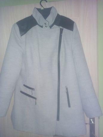 Płaszcz wygląda jak nowy!