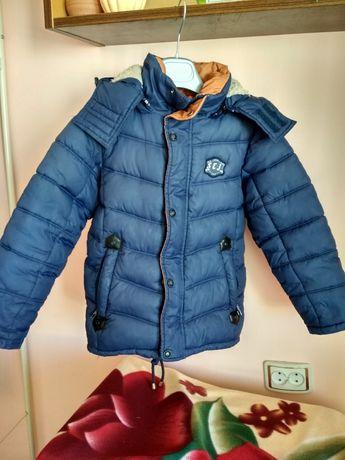 Продам зимову куртку на хлопчика 7-8 років