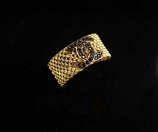 Złoto 585 - złoty pierścionek na wzór CC z cyrkoniami  r.14