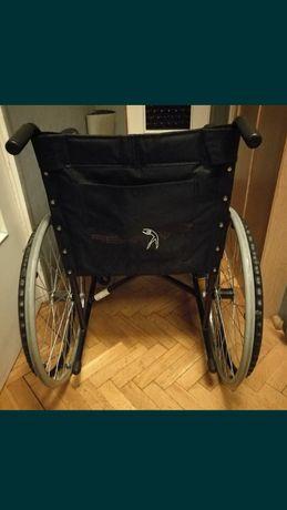 Wózek inwalidzki plus pampersy gratis.
