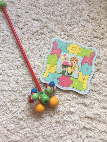 Drewniane zabawki zegar i pchacz karuzelka